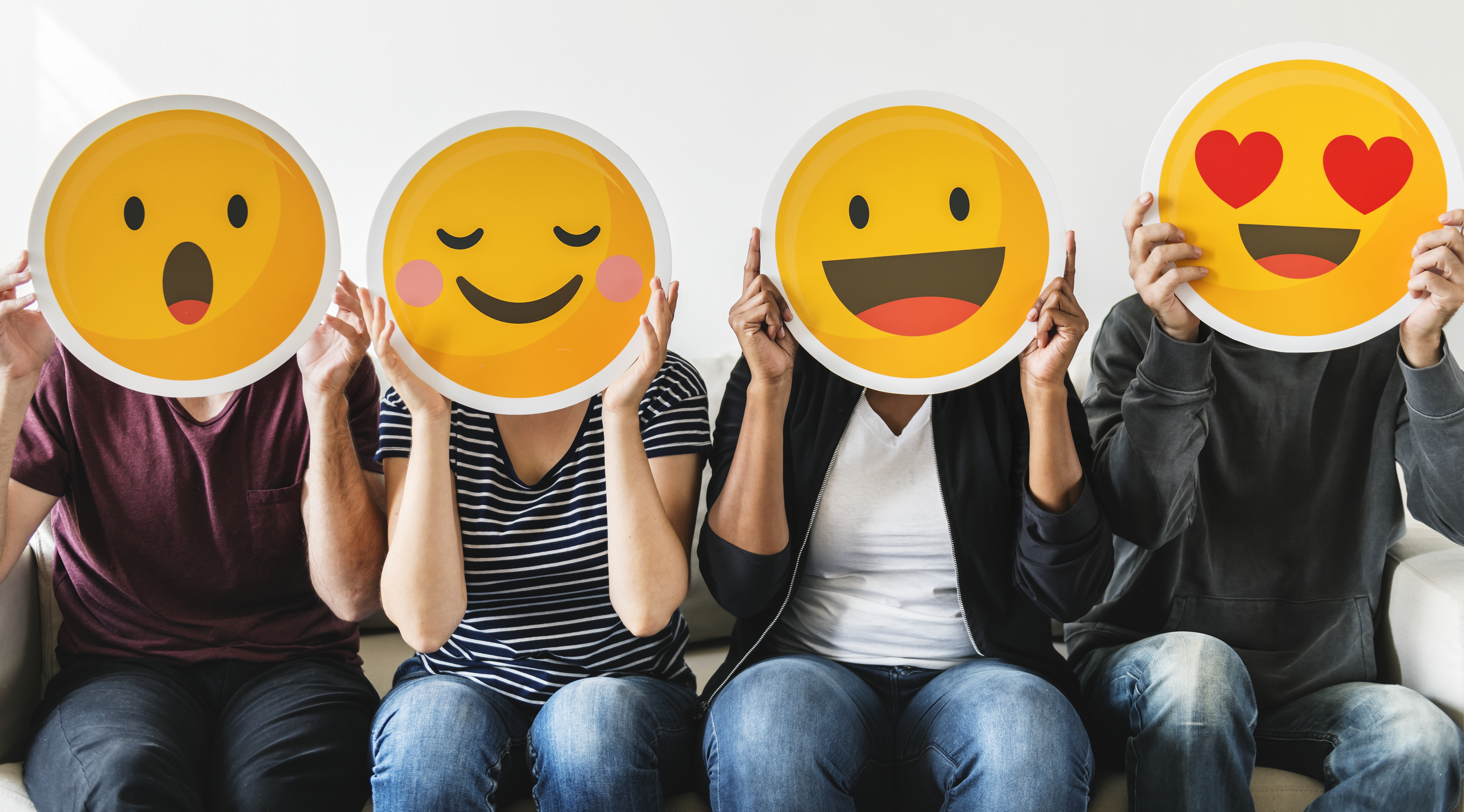 diverse-people-holding-emoticon