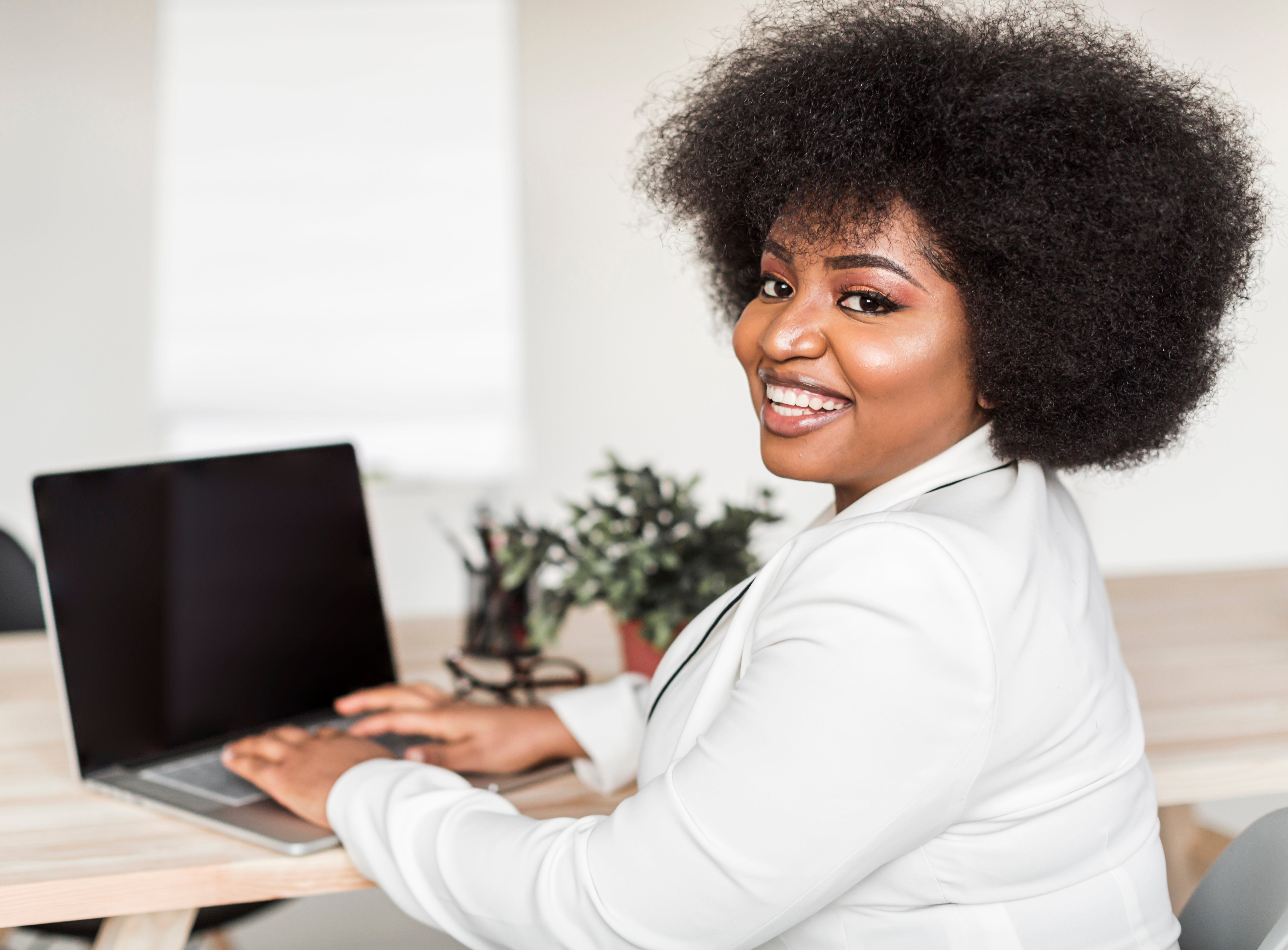 front-view-woman-working-laptop